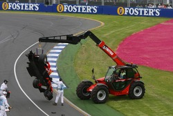 The wrecked car of Felipe Massa is towed away