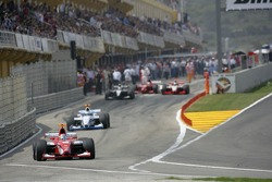 Cars leave the pit lane after stalling on the grid
