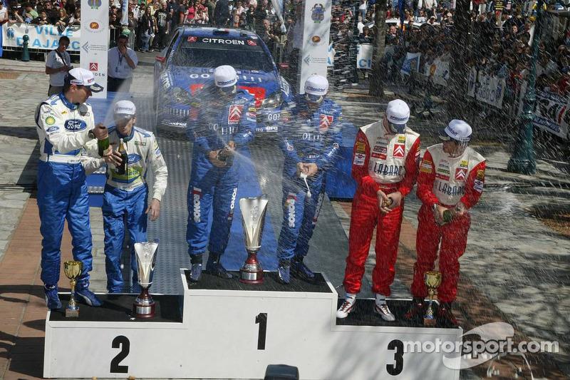 Podium: les vainqueurs ébastien Loeb et Daniel Elena, avec les deuxièmes Marcus Gronholm et Timo Rau