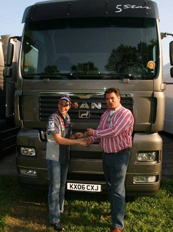 The General Director of MAN Truck and bus b.v Bert van Hasselt hands over the keys to the new Midland MAN trucks to Christijan Albers, Midland MF1 Racing