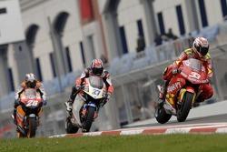 Marco Melandri, Gresini Honda; Casey Stoner, LCR Honda; Dani Pedrosa, Repsol Honda