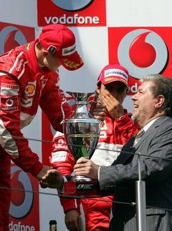 Podium: race winner Michael Schumacher with Kurt Beck