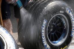 Scuderia Toro Rosso members clean Michelin tires