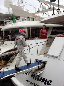 Kimi Raikkonen boards a yacht