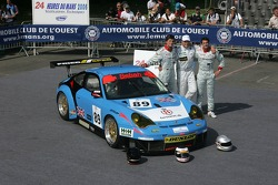 Thorkild Thyrring, Xavier Pompidou, and Christian Ried pose with the Sebah Automotive Porsche 911 GT3 RSR