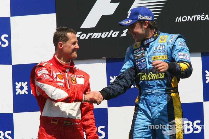 Podio: ganador de la carrera Fernando Alonso  segundo lugar Michael Schumacher