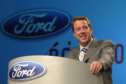 Bill Ford takes part in an employee pep rally at Ford World Headquarters
