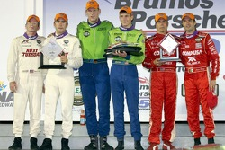 DP podium: class and overall winners Jorg Bergmeister and Colin Braun, with second place Mike Rockenfeller and Patrick Long, and third place Scott Pruett and Luis Diaz