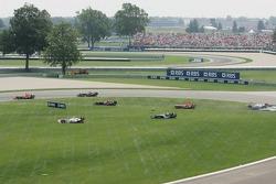 Crash at first corner: Mark Webber, Takuma Sato and Franck Montagny