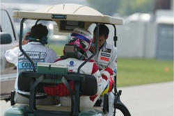 Franck Montagny and Juan-Pablo Montoya get a lift back to the paddock