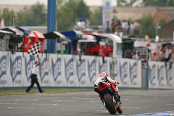Dani Pedrosa takes the checkered flag