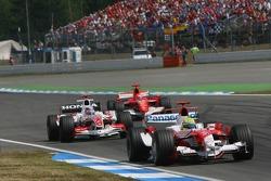 Ralf Schumacher, Takuma Sato and Michael Schumacher