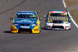 Grant Denyer and Mark Howard fight for Turn 4