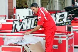 A mechanic puts away the garage sign of Michael Schumacher