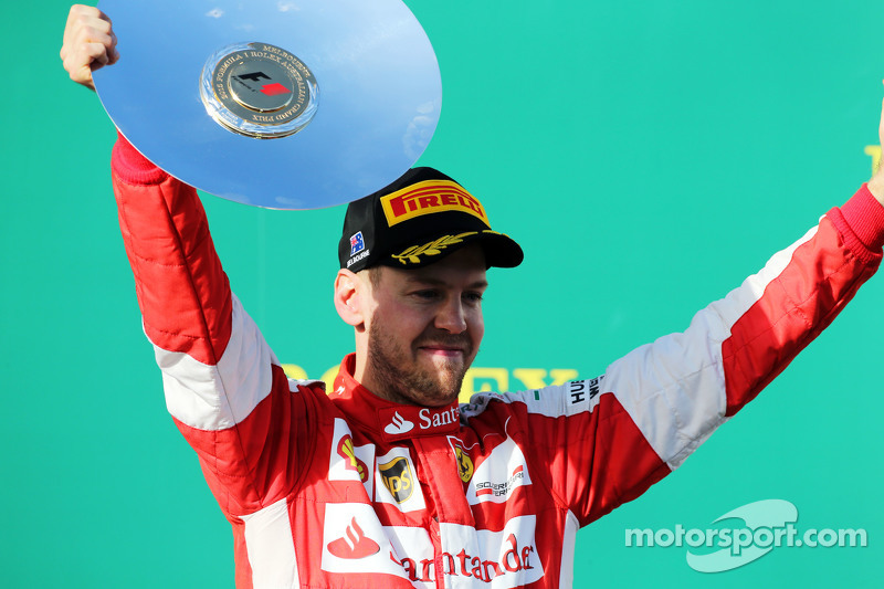 Sebastian Vettel, Ferrari merayakan raihan peringkat ketiganya di podium