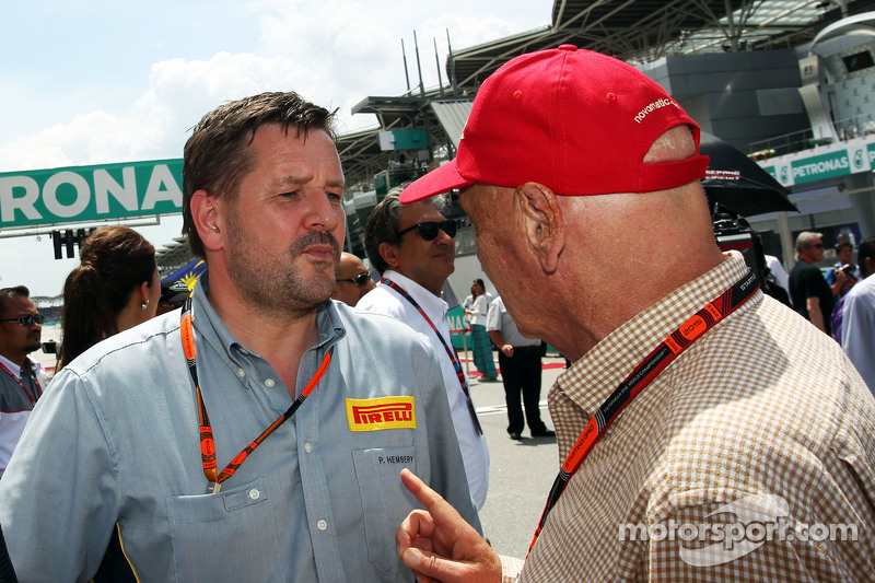 Paul Hembery, Pirelli Motorsport Director with Niki Lauda, Mercedes Non-Executive Chairman on the grid