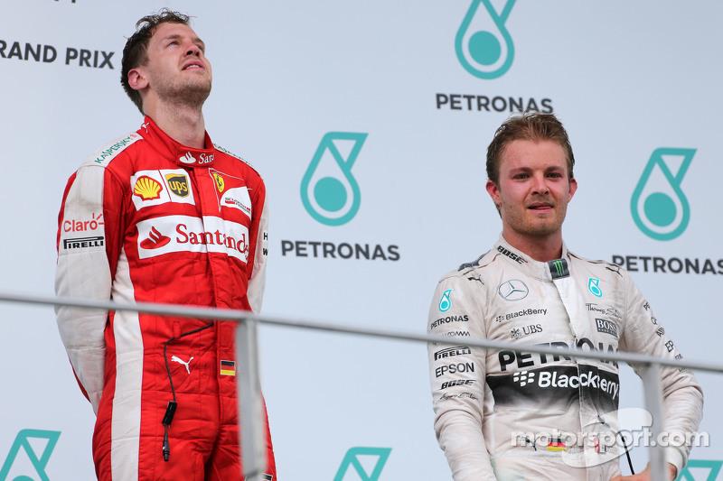 Sebastian Vettel, Scuderia Ferrari y Nico Rosberg, Mercedes AMG F1 Team