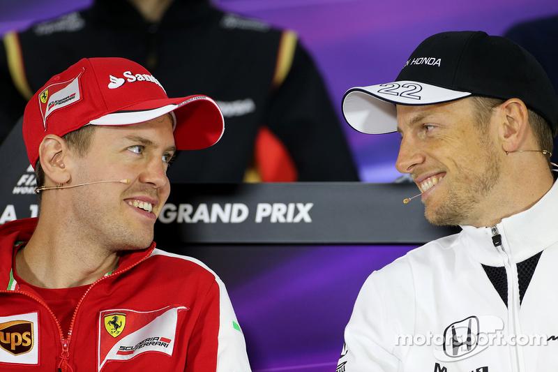 Sebastian Vettel, Scuderia Ferrari, und Jenson Button, McLaren-Honda