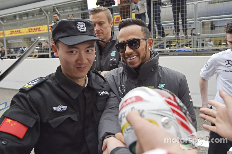 Lewis Hamilton Mercedes AMG F1 signs autographs for the fans