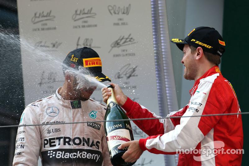 Lewis Hamilton, Mercedes AMG F1 Team, dan Sebastian Vettel, Scuderia Ferrari