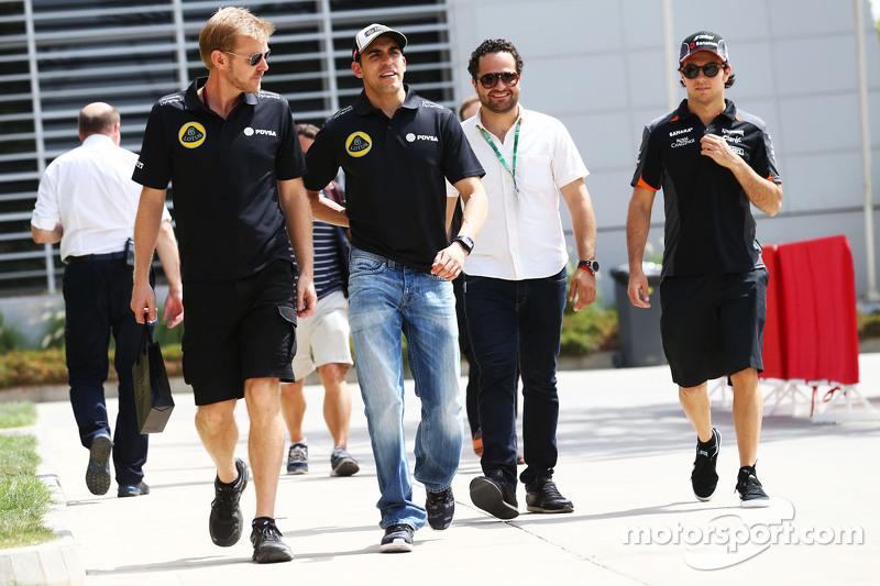 Pastor Maldonado, Lotus F1 Team with Andy Stobart, Lotus F1 Team Press Officer,