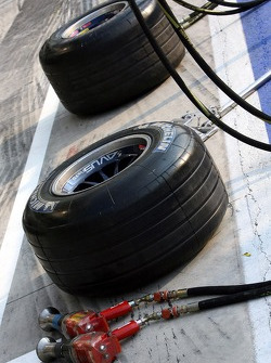 Michelin tyres and an air wrench in front of the Scuderia Toro Rosso garage