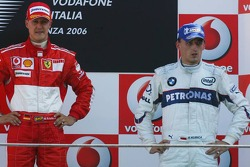 Podium: race winner Michael Schumacher with Robert Kubica