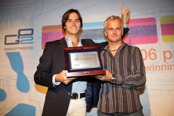 Series runner-up Nelson A. Piquet accepts his trophy from Heikki Kovalainen