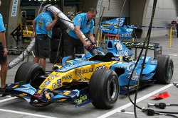 Renault mechanics practice refueling the car of Fernando Alonso