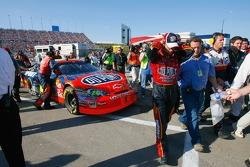 Jeff Gordon walks to the garage after having engine problems