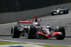 Kimi Raikkonen leads Fernando Alonso