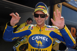 Pole winner Valentino Rossi celebrates