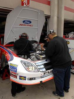Crew chief Michael McSwain lends a hand with race preparation on the Ford Fusion driver by Ken Schrader
