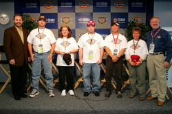 Race to Riches contest: a group shot of the finalists with Texas Motor Speedway President Eddie Gossage and Jon Ragsdale VP of Marketing and Merchandising for Williamson-Dickie Mfg. Co.