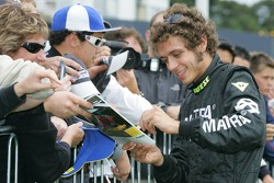 Valentino Rossi signs autographs for fans