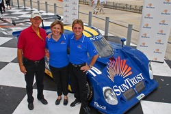 Jim France, Krista Massey and Wayne Taylor pose with Taylor's SunTrust car