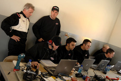 Ricky Rudd and Butch Hylton look over the data gathered from the Robert Yates Racing engineering staff