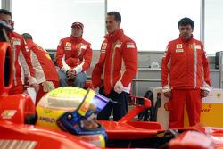 Kimi Raikkonen and Michael Schumacher look on