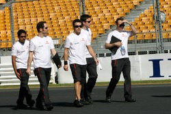 Fernando Alonso, McLaren Mercedes, walks round the circuit