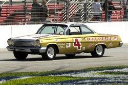 1960 NASCAR Grand National Champion Rex White in a replica of his 1962 Chevy Impala Impala