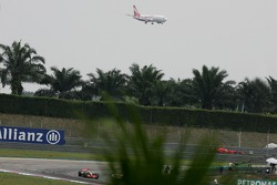 Lewis Hamilton, McLaren Mercedes, MP4-22 with and Airliner coming into land in the background