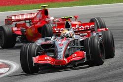 Lewis Hamilton, McLaren Mercedes, MP4-22 leads Kimi Raikkonen, Scuderia Ferrari, F2007