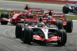 Lewis Hamilton leads Felipe Massa and Kimi Raikkonen