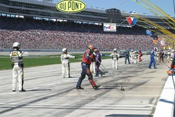 Crews clean the pit lane after Pitstops
