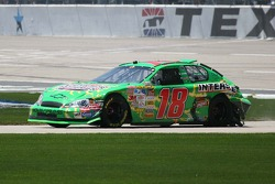 J.J. Yeley takes his damaged car to the garage area