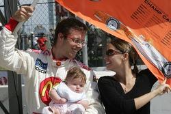 Pole winner Sébastien Bourdais celebrates with wife Claire and daughter Emma