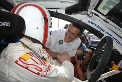 Dr Mario Theissen (BMW Motorsport Director) talks with Olaf Manthey
