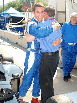 Winner Dane Cameron greets father Rick
