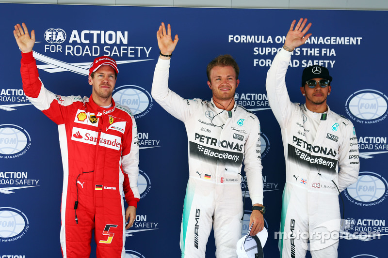 Sebastian Vettel, Ferrari, sowie Nico Rosberg und Lewis Hamilton, beide Mercedes AMG F1