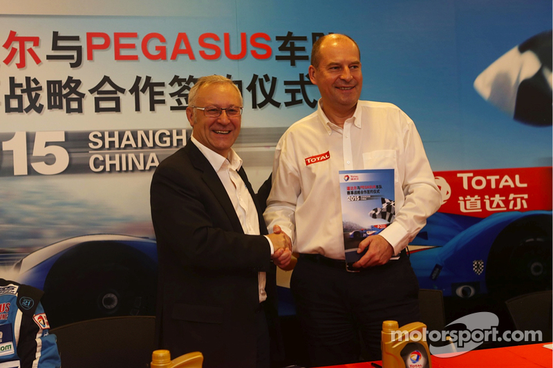 Remy Brouard, Pegasus Racing sports marketing manager and Patrice Devemy, managing director of Total Lubricants China